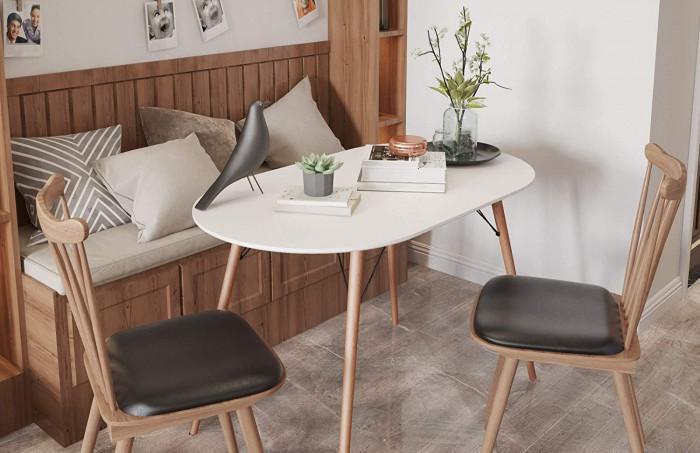 4. Компактна овална маса с бял плот