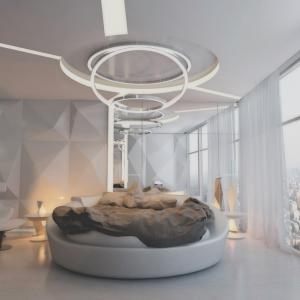 Кръгло легло и бял интериор